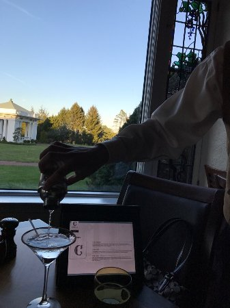 The Circular: View from the table while server pours their signature chocolate martini