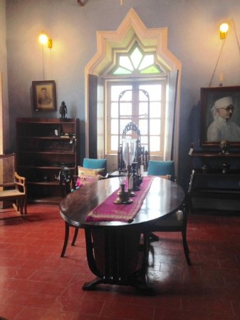 Sangolda, India: BEAUTIFUL ART DECO DINING TABLE SURROUNDED WITH BEAUTIFUL ARTIFACTS AND IMPOSING PORTRAITS.