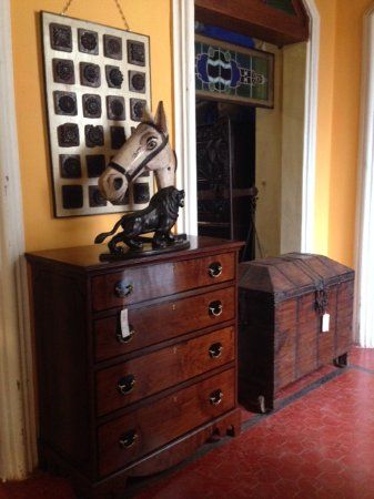 Sangolda, India: MAGNIFICIENT CHEST OF DRAWERS AND IMPOSING HORSE HEAD AND CARVED ARCHITECTURAL PANEL.