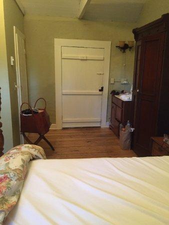 Locust Dale, VA: View of front door and sink opposite from bathroom