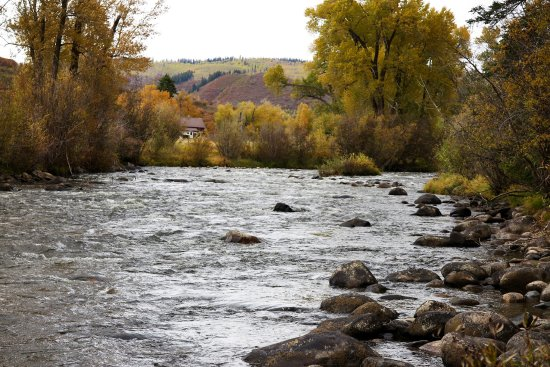 Clark, CO: The Elk River runs right along the resort property.