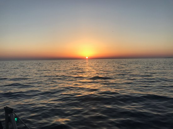Firostefani, Hellas: View of sunset from the water:)