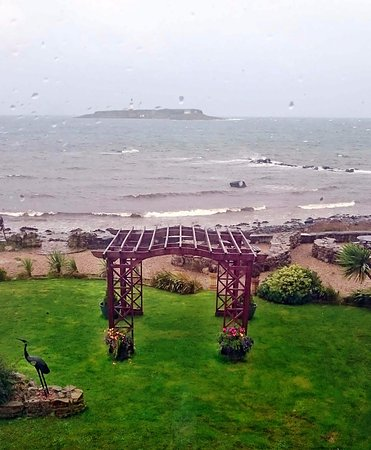 Kildonan, UK: On a wild day from bedroom 4, so it would be wonderful in bright sunshine.
