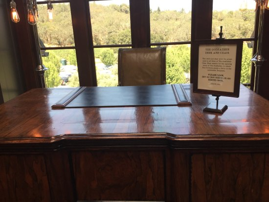 Geyserville, CA: The Godfather desk, scenic pics and a huge wine cart with of course Coppola's wines!