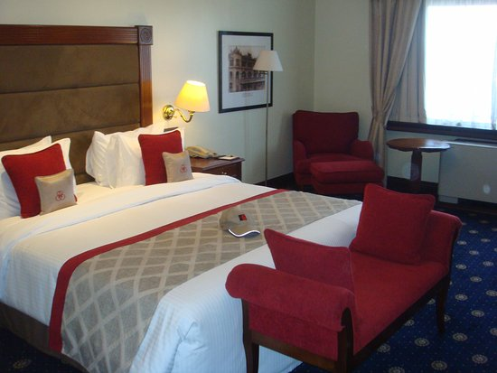 Sarova Stanley: Large comfortable room including an easy chair in the corner