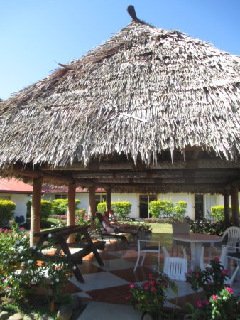 "Gecko's Resort: Enjoying the ""Relaxation Bure"" in the courtyard"