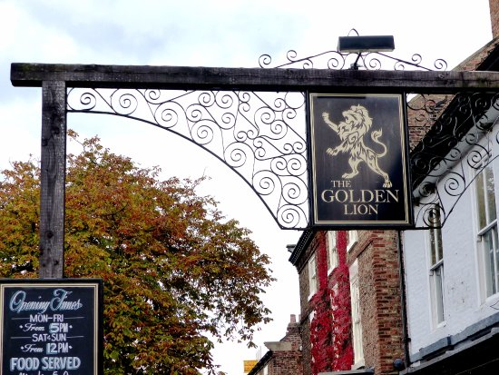 The Golden Lion: Unusual   pub sign  on distinct timber  and metal structure  in front of pub