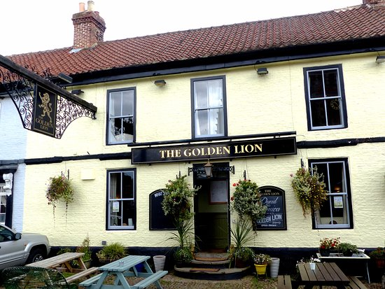 The Golden Lion: Traditional pub front   with seating outside for fine days