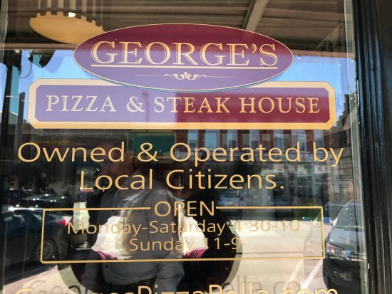 Pella, IA: Sign to George's Pizza & Steak House