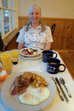 Main Street Cafe: Oatmeal with fresh fruit for my wife. Eggs, bacon,& home fries for me. Orange juice and coffee.