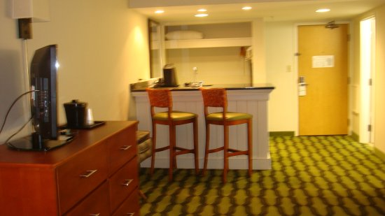 view of entrance and bar/kitchenette area