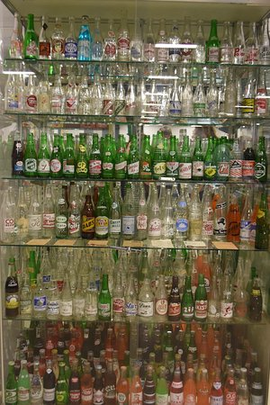 Keystone Tractor Works: A huge display of old bottles and the curator knows the details on every bottle!