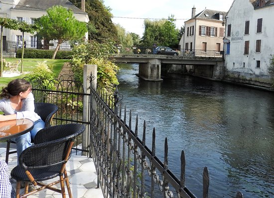Pacy-sur-Eure, France: View from BelAmi on river Eure. Angler on bridge.