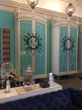 "Kimpton Hotel Monaco Philadelphia: The ""sun"" houses the coffee urns-The ""moon"" the wine items."