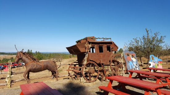 Camino, CA: Life size horse and carriage rusted metal