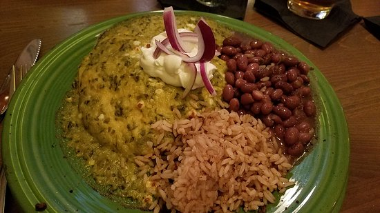 Hudson, WI: Enchiladas Suizas de Puerco...its good!  Seasoned pulled pork in corn tortillas with green chili