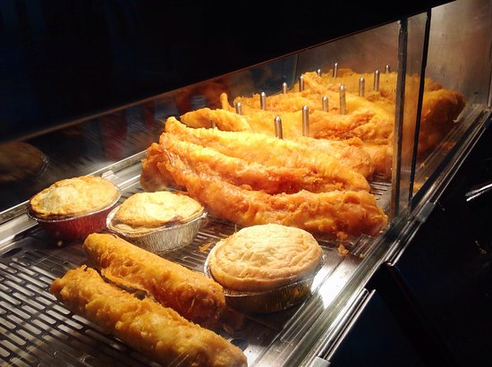 Hot box full of pies fish and battered sausages picture for The fish friar