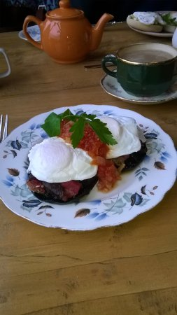 Bexhill-on-Sea, UK: Field mushrooms topped with Roasted veg, Soft poached eggs and tomato salsa.