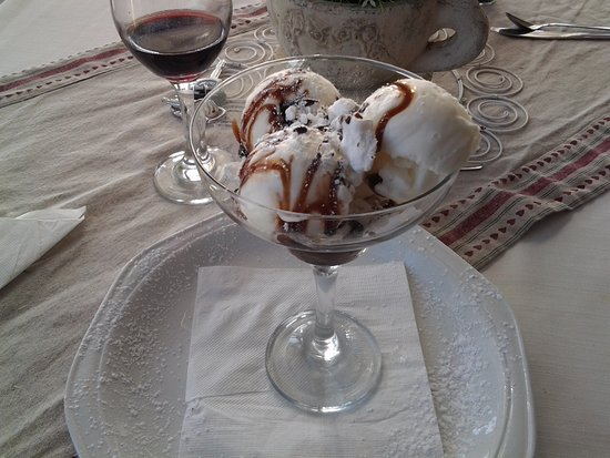 Melkbosstrand, South Africa: ....decadent chocolate-sundae dessert & glass of red wine