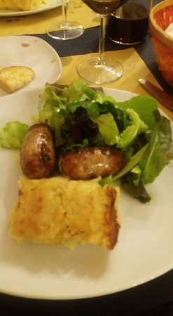 Agriturismo La Pietriccia: Sausage from the locally raised Cinta Sinese pig, potato cake, and fresh greens