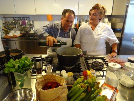 Trustevertastes : Paula showing my uncle how to make ragu.