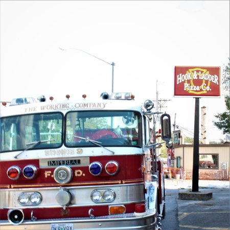 Hollister, MO: Fire truck in front of Hook and Ladder Pizza Co