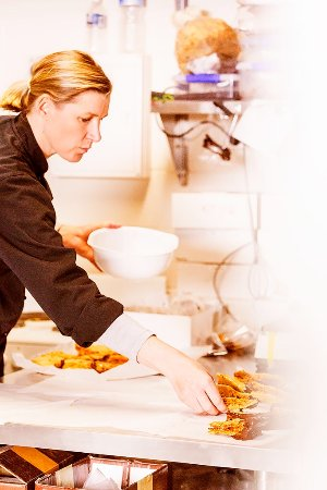 Kettering, Australia: Home made honeycombe. Martine fully focused on producing our dipped honeycombe.