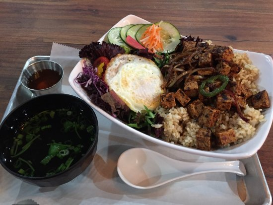 Rogers, AR: Brown rice bowl with a fried egg and combo soup.