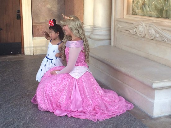 Shanghai, China: Princess Aurora greets a fan in Storybook Court