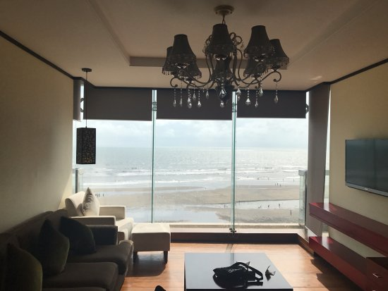 Living room area with panoramic ocean view - Picture of