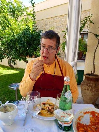 Cooking Class al Ristorante Nettuno da Siciliano : My trying a semi-hot pepper from the fish Secundo