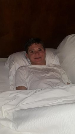 Stevenson Ranch, CA: My son Joey chillin in his comfy hotel bed