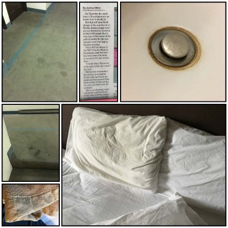 La Grande, OR: Stains on carpets, dingy linens, rusty sink, frayed blanket.
