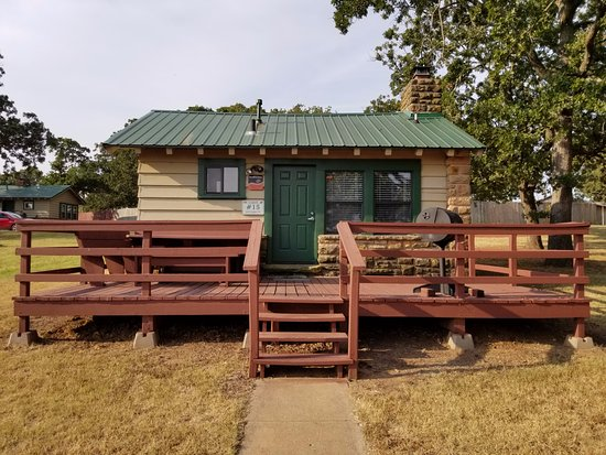 Stillwater, OK: One of the many Cabins that can be rented with large porch and BBQ pit
