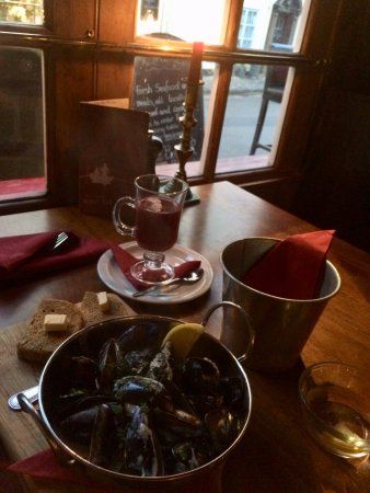 Smugglers: Candlelight dining by the window. Mussels (starter portion) and mulled wine!