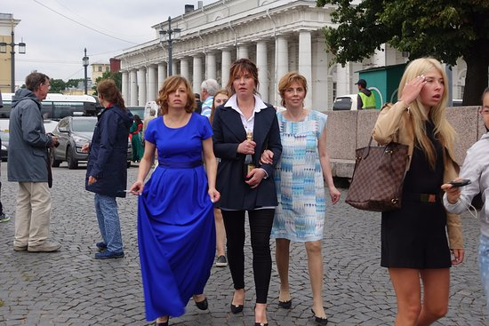 Naval Museum in Old Stock Exchange and Rostral Columns: Wedding attendees come bearing gifts (vodka?) Stock Ex. scene