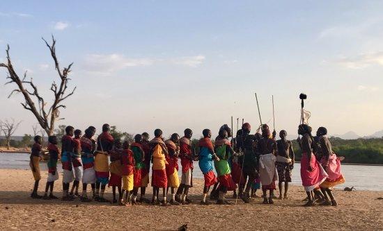 Sasaab Lodge: The Samburu people gathering to sing and dance for us on the river