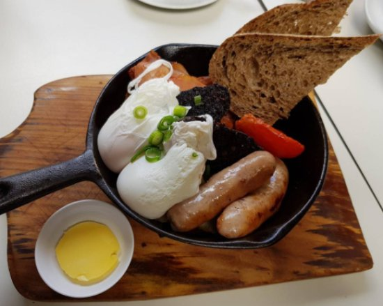 Skillet breakfast ... poached eggs, pork sausage, black pudding, toast