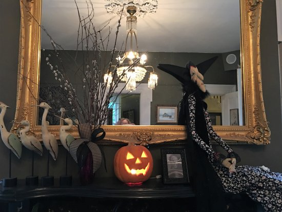 Crane & Pelican: Fireplace mantle in middle room decorated for Halloween