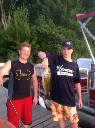 The Blind Tiger: This is my adorable grandsons Agate Lake catching a beautiful bass off of our dock. So love them