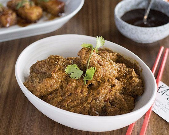 Ka-Chin: Beef Rendang - Slow cooked beef cubes in an aromatic curry paste mixed with coconut milk.