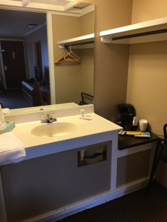 Vandalia, OH: Vanity area, clean, but no drain cover in sink.