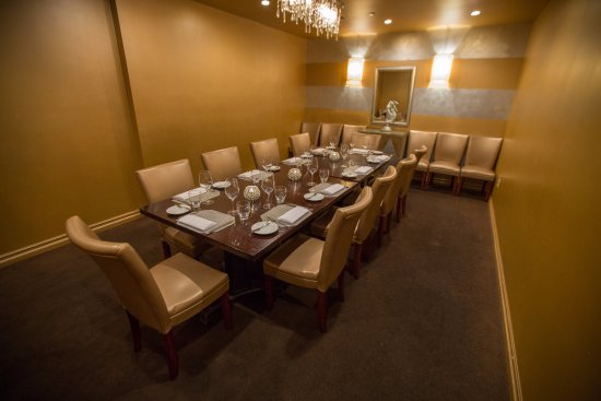 PAON Restaurant Wine Bar Private Dining Room Equipped With A TV Screen For Business