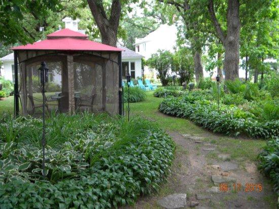 Whitehall, WI: Backyard gardens and gazebo dining.
