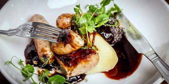 Cotgrave, UK: Owen Taylor's award winning Lincolnshire sausage, spring onion mash & black pudding bon bon