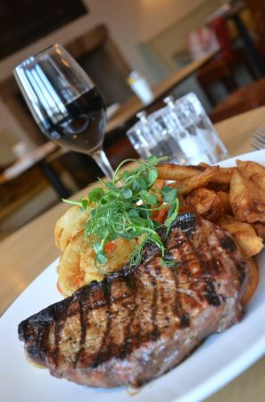 Lowick, UK: 28 Day matured Northumbrian Sirloin Steak, served with home made onion rings and hand cut chips.