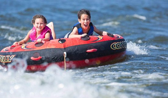 Young Harris Water Sports: Customers tubing off the back of our ski boats for rent