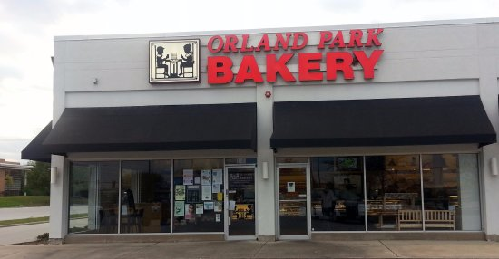 front of & entrance to Orland Park Bakery