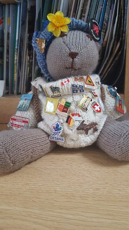 Menai Bridge, UK : Rambler Ted with his badges from all over the world.
