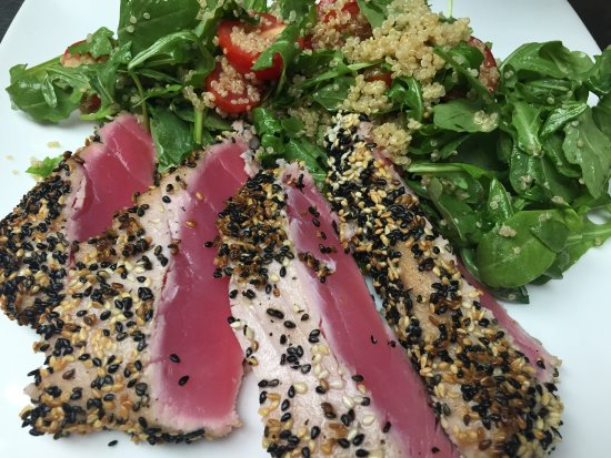 Marlborough, MA: Sesame Crusted Tuna with a salad of arugula, quinoa and cherry tomatoes.